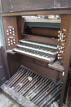 console of organ bulldozed